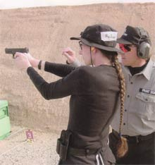 Picture of woman shooter at Front Sight firing range.