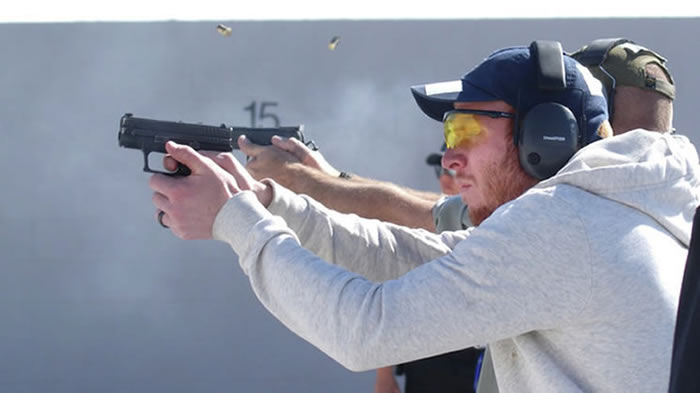 Logan resident Creed Stephens shoots at a target during a firearms training class. (Photo: Flint Stephens)